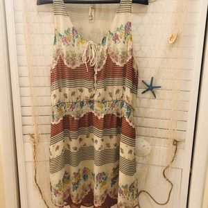 Free People sleeveless dress with pockets.